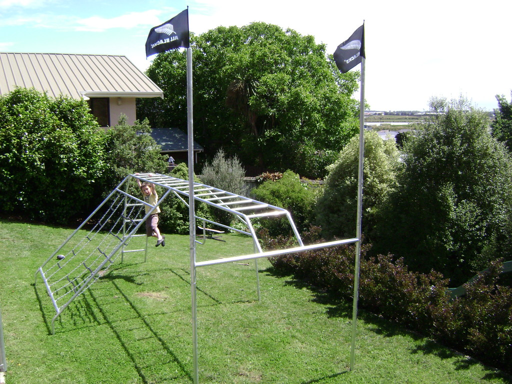 Rugby posts doing the monkey bars